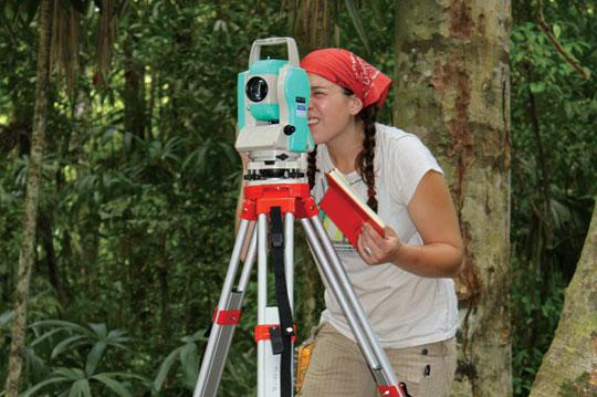 Student using total mapping station in Belize