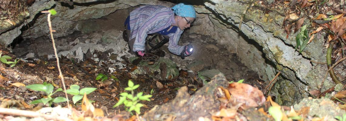 Archaeologist exploring a cave